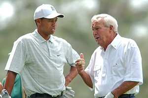 Four-time Masters champion Arnold Palmer, right, and three-time Masters champion Tiger Woods, left, chat before the start of the Par 3 Contest at the Augusta National Golf Club in Augusta, Ga., Wednesday, April 7, 2004.