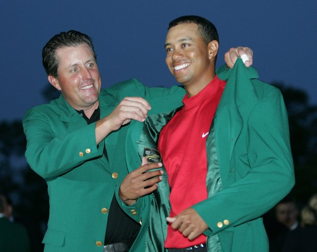 Tiger Woods, right, gets the Green Jacket from Phil Mickelson, left, after winning the 2005 Masters at the Augusta National Golf Club in Augusta, Ga.,