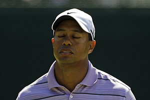 Tiger Woods reacts after a par putt on the fifth hole during the third round of the Masters golf tournament in Augusta, Ga., Saturday, April 10, 2010.