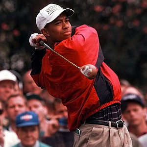 Tiger Woods follows his tee shot on number two during practice for the Masters at the Augusta National Golf Club in Augusta, Ga., Tuesday, April 9, 1996.
