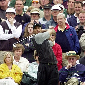 A sea of faces of Masters golf fans surround Tiger Woods as he hits his tee shot on the 3rd hole during the first round of the 2001 Masters at the Augusta National Golf Club in Augusta, Ga., Thursday, April 5, 2001