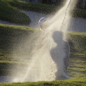 Martin Laird of Scotland hits out of a bunker onto the 18th green during the third round at the Cadillac Championship.