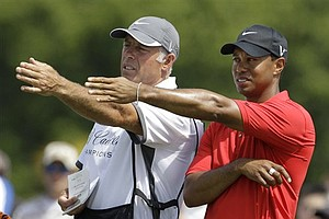 Tiger Woods, right, and caddie Steve Williams, left, line up a putt on the fourth hole during the final round at the Cadillac Championship.