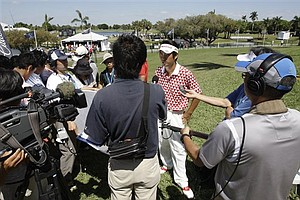 Yuta Ikeda of Japan, center, is interviewed by the Japanese media following his final round at the Cadillac Championship, Sunday, March 13, 2011.