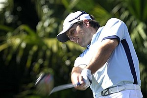 Francesco Molinari, from Italy, tees off on the eighth hole during the final round at the Cadillac Championship.