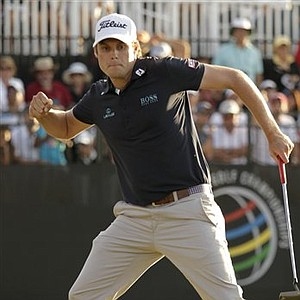 Nick Watney celebrates making a birdie putt on the 18th hole during the final round of the Cadillac Championship in Doral, Fla.
