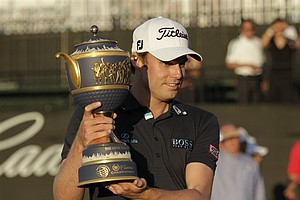 Nick Watney poses with the trophy after winning during the Cadillac Championship in Doral, Fla.