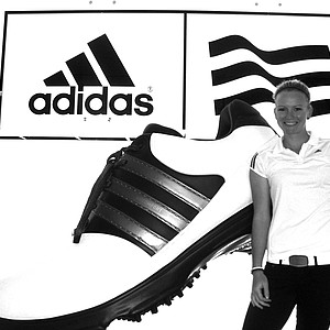 Nicole Noelle Smith in front of a big display in the waiting room of the Adidas headquarters in Carlsbad.
