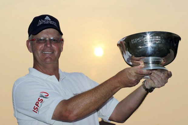 Sandy Lyle of Scotland poses with the trophy after the final round of the ISPS Handa Senior World Championship presented by Mission Hills China and played on the World Cup Course, Mission Hills on March 13, 2011 in Shenzhen, Guangdong.