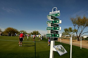 A field of 134 players will participate in the inaugural RR Donnelley Founders Cup at Wildfire Golf Club. Signs near the practice green lead spectators around the course.