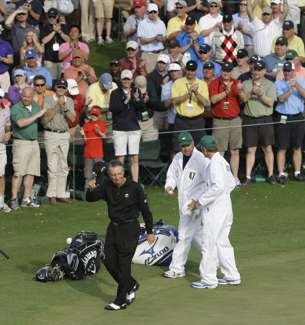 Gary Player of South Africa waves to the gallery after his second round of the Masters golf tournament at the Augusta National Golf Club in Augusta, Ga., Friday, April 10, 2009.