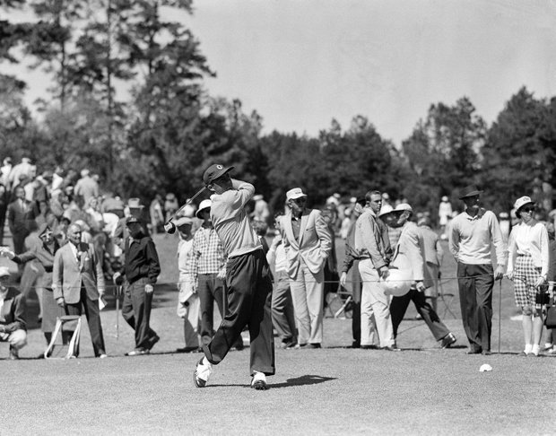 Gary Player of Johannesburg, South Africa drives from the 9th tee during the third round of the Masters Golf Tournament in Augusta, Ga. on April 6, 1957.