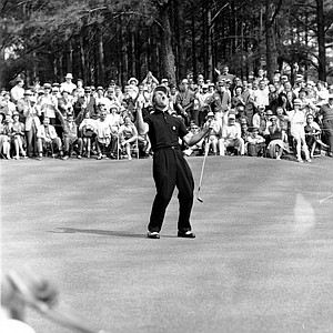 Gary Player reacts with a cheer as he drops a birdie putt on the sixth green in third round of the Masters Golf Tournament at Augusta National Golf Club in Augusta, Ga., on April 8, 1961.
