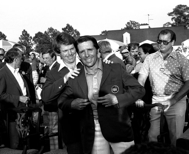 Tom Watson, left, former Masters winner, is shown putting the Green Jacket of the August National Golf Club on the 1978 winner, Gary Player, April 10, 1978. Player won with an 11-under-par score for the tournament.