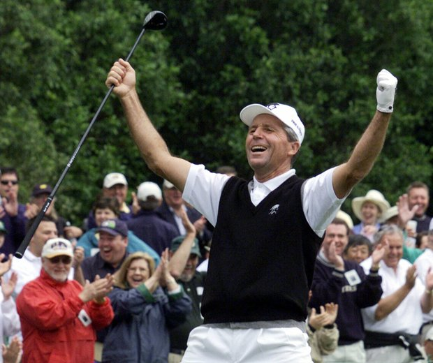 Gary Player, from South Africa, reacts with the gallery after making a long birdie putt on the 1st hole during the first round of the 2001 Masters at the Augusta National Golf Club in Augusta, Ga., Thursday, April 5, 2001.