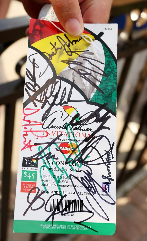 A fan holds a ticket covered in autographs during the Arnold Palmer Invitational at Bay Hill, Saturday, March 15, 2008.