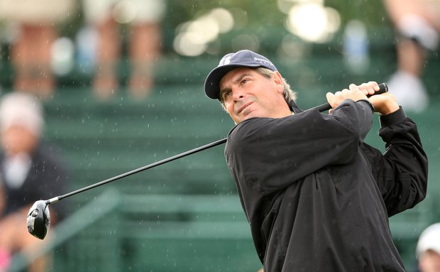 Fred Couples tees off in the rain during the Arnold Palmer Invitational at Bay Hill, Friday, March 14, 2008.