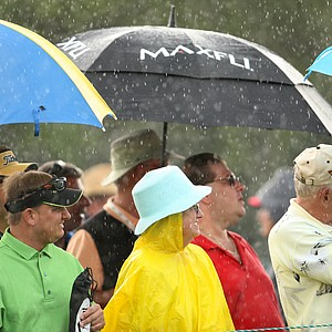 Fans stand in the rain to watch Fred Couples, Paul Goydos and Stephen Ames tee of during the Arnold Palmer Invitational at Bay Hill, Friday, March 14, 2008.