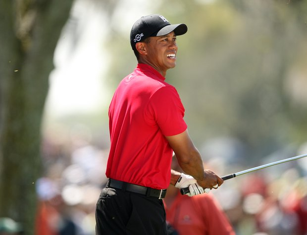 Tiger Woods watches his shot out of the rough in the 3rd fairway during the final round of the Arnold Palmer Invitational at Bay Hill, Sunday, March 16, 2008.