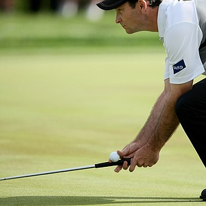 Orlando, FL--03/267/09--Mark Wilson gets down to read a putt during the Arnold Palmer Invitational at Bay Hill Club and Lodge.