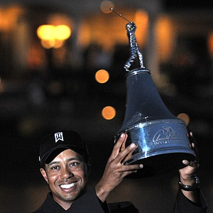 Tiger Woods lifts the trophy for winning the Arnold Palmer Invitational golf tournament at Bay Hill in Orlando, Fla., Sunday, March 29, 2009. Woods closed with a 3-under 67 for a one-shot victory over Sean O'Hair.