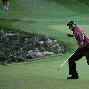Orlando, FL--03/29/09--Tiger Woods reacts to sinking a birdie putt and winning the Arnold Palmer Invitational at Bay Hill Club and Lodge.