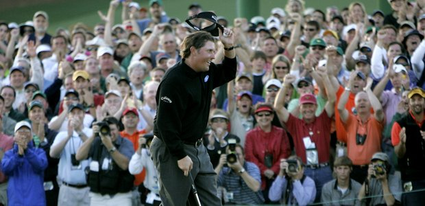 Phil Mickelson tips his hat to the gallery on the 18th hole after winning the 2006 Masters golf tournament at the Augusta National Golf Club in Augusta, Ga., Sunday, April 9, 2006.