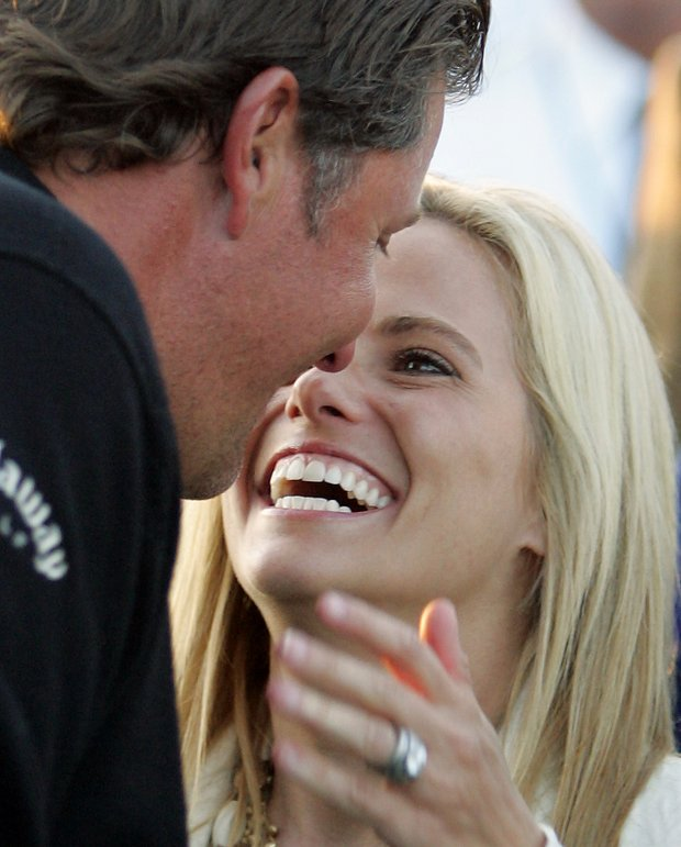 Phil Mickelson gets a kiss from his wife Amy after winning the 2006 Masters golf tournament at the Augusta National Golf Club in Augusta, Ga., Sunday, April 9, 2006.