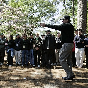 Phil Mickelson checks his line needed to hit out of the rough on the second hole during the third round of the 2007 Masters golf tournament at the Augusta National Golf Club in Augusta, Ga., Saturday, April 7, 2007.