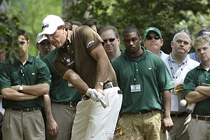 Phil Mickelson hits right-handed to get out of the rough from the first hole during the second round of the Masters golf tournament at the Augusta National Golf Club in Augusta, Ga., Friday, April 10, 2009.