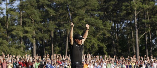 Phil Mickelson celebrates on the 18th green after winning the Masters golf tournament in Augusta, Ga., Sunday, April 11, 2010.