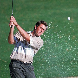 Phil Mickelson blasts out of a trap on the 16th hole during the third round of the Masters at the Augusta National Golf Club in Augusta, Ga., Saturday, April 8, 1995.