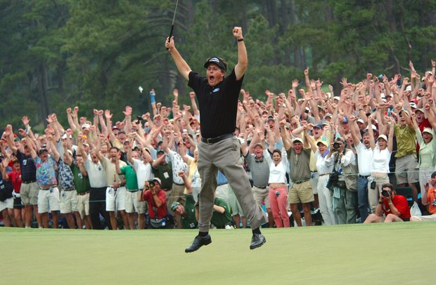 Phil Mickelson celebrates after winning the Masters golf tournament with a nine-under-par at the Augusta National Golf Club in Augusta, Ga., Sunday, April 11, 2004.