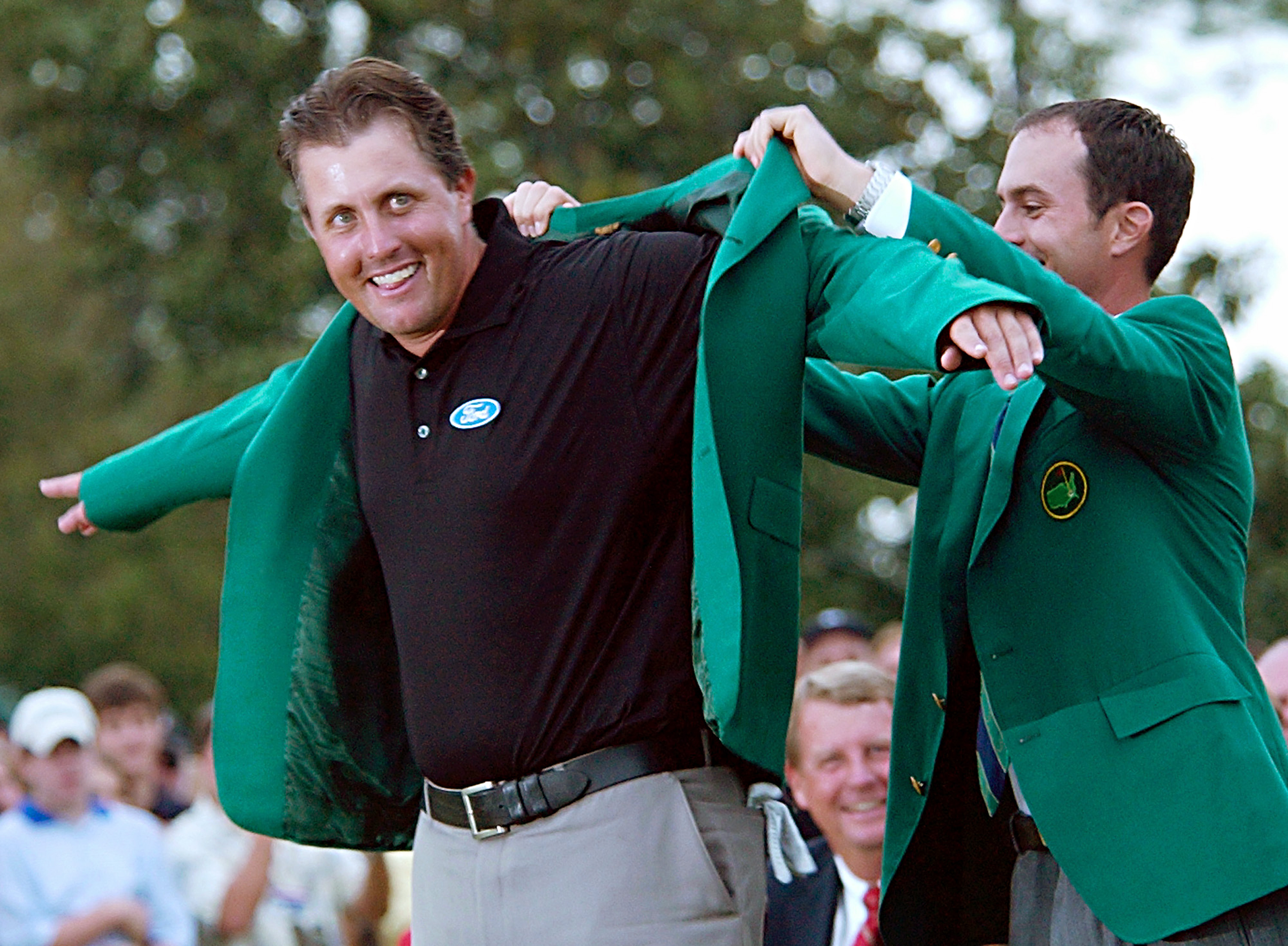 Photo By Associated Press Phil Mickelson Puts On His