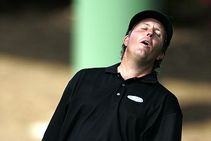 Phil Mickelson reacts after missing his birdie putt on the 10th hole during first round play of the Masters golf tournament at the Augusta National Golf Club in Augusta, Ga., Thursday, April 6, 2006.