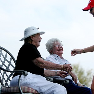 Paula Creamer greets a couple of the original LPGA founders, Shirley Spork and Marilynn Smith, at No. 18 after Round 1.