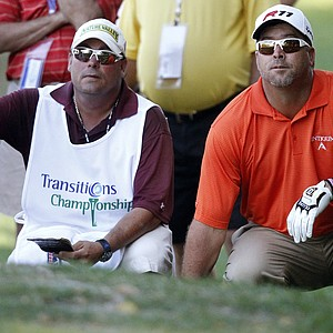 Chris Couch with his caddie Ronnie McCann during Round 1 of the Transitions Championship.