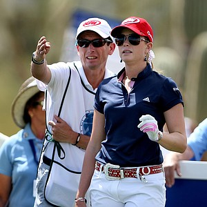 Paula Creamer talks with her caddie, Colin Cann, during Round 1.