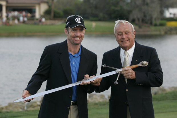 Rod Pampling (L) is presented the Bay Hill trophy by Arnold Palmer after the fourth round of the Bay Hill Invitational presented by MasterCard at the Bay Hill Club in Orlando, Florida on March 19, 2006.