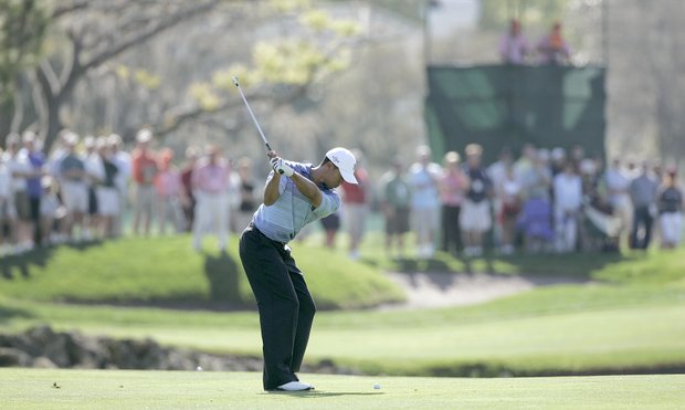 Tiger Woods plays his second shot on the 13th hole in action during the first round of the Bay Hill Invitational presented by MasterCard at the Bay Hill Club in Orlando, Florida on March 16, 2006.