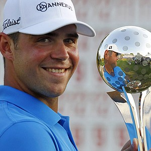 Gary Woodland celebrates with his trophy after winning the 2011 Transitions Championship.