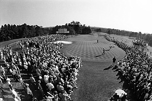 Thousands of golf fans line up to watch action on the 18th green of the Augusta National Golf Club during the third round of the Masters Golf Tournament, April 10, 1971 in Augusta, Ga.
