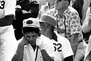Lee Tervino sits on his golf bag waiting for his turn to tee off in the Par 3 Contest prior to the Masters Golf Tournament at the Augusta National Golf Club in Augusta, Ga., on April 6, 1972.