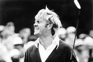 Jack Nicklaus watches his putt miss the cup and give him a bogey on the 18th during the third round of the Masters Golf Tournament on April 8, 1972 at the Augusta National Golf Club in Augusta, Georgia.
