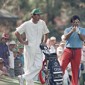 Seve Ballesteros of Spain checks to see which club he will use during a practice round at the Augusta National Golf Club as he prepares for the Masters Golf Tournament, April 5, 1988.
