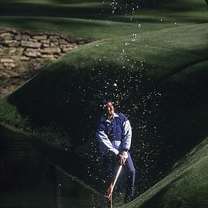 Seve Ballesteros of Spain plays his ball out of Rae's Creek on the 13th hole during the US Masters at Augusta National Golf Club, April,1989 in Augusta,Georgia, USA.