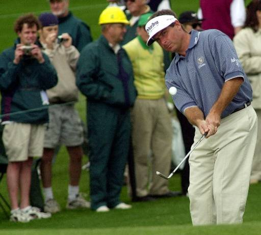 Fred Couples chips on 1 at the Augusta National Golf Club during practice for the 2000 Masters.