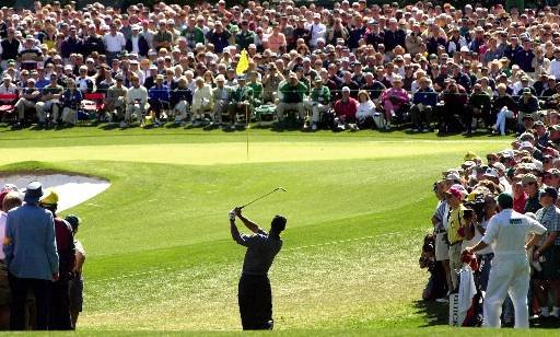 Tiger Woods hits to 2 as a packed gallery watches during first round play of the 2000 Masters at the Augusta National Golf Club in Augusta, Ga., Thursday, April 6, 2000.