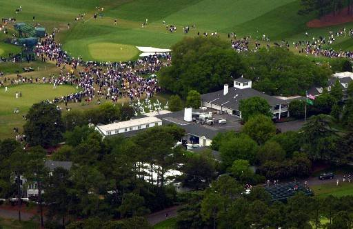 Spectators line the course during third round play of the Masters golf tournament at the Augusta National Golf Club in Augusta, Ga., Saturday, April 8, 2000.