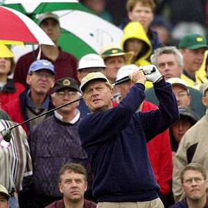 Jack Nicklaus watches his tee shot on the third hole during third round play of the Masters.
